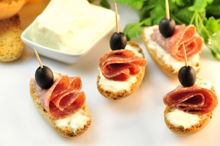 croutons with sliced   8203;  8203;salami cheese and olives Stock Photo