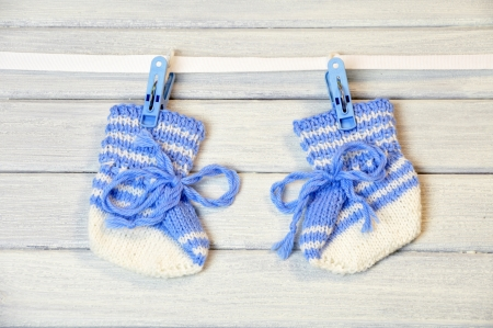 newborn socks hanging on the wire Stock Photo