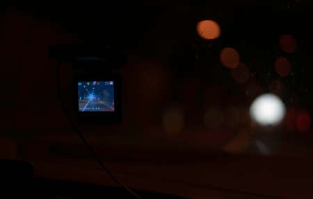 Car video camera (dash cam) inside of car on highway with blurred background of highway road, from perspective of the driver. Concept of safety camera ... 版權商用圖片