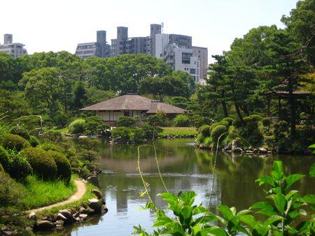 hiroshima: Old and New of Japan juxtaposed in a Japanese garden in Hiroshima, Japan 2008