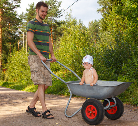Young father walking with his little son photo