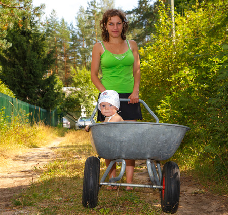 Young mother walking with her baby photo