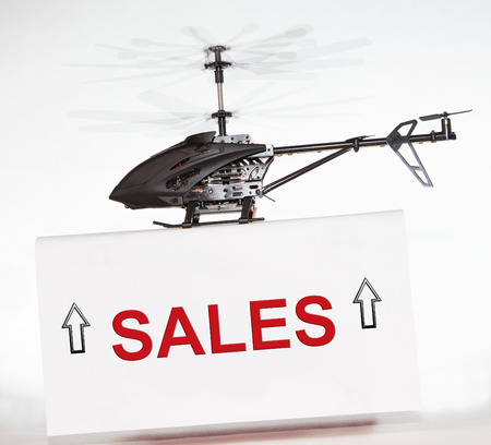 Sales up with helicopter photo