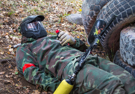 blow up: Lying soldier is going to blow up grenade on training