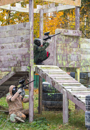 fortification: Two paintball shooters defending the fortification Stock Photo