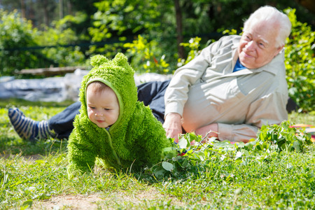 dacha: Senior man and baby on nature