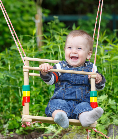 dacha: Smiling baby swinging