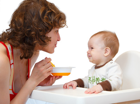 feeds: Mother feeds her little baby Stock Photo