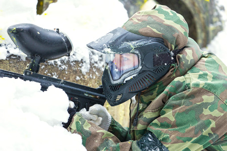 bank activities: Closeup of paintball player in mask in winter Stock Photo