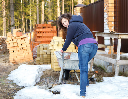 trundle: Young woman enjoys work in nature on construction site