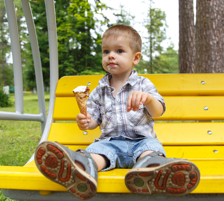 smudgy: Smudgy funny boy eating ice-cream Stock Photo