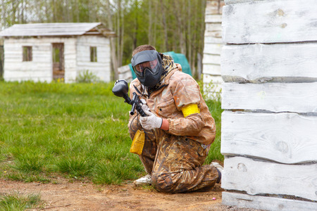 paint gun: Paintball player with paint gun