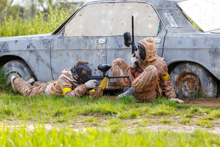 defend: Two friends defend old car in paintball mission