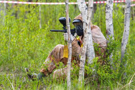 ambush: Paintball ambush in birch trees Stock Photo