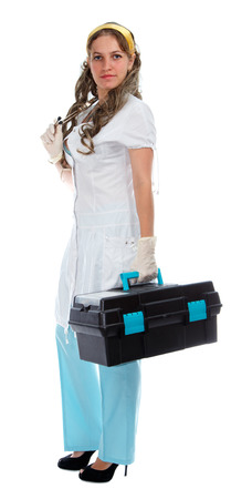 first aid box: Young beautiful doctor with first aid box
