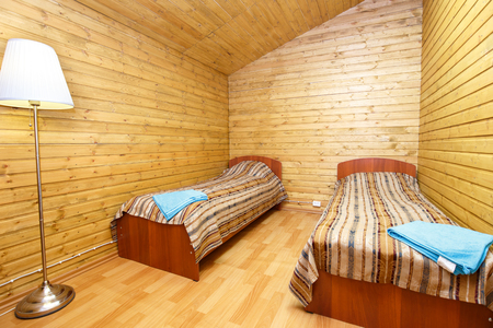 double room: Double room with separate beds in motel Stock Photo