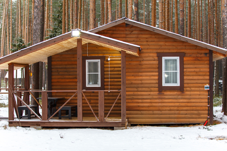 storied: Big wooden bathhouse in winter
