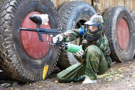 ambush: Girl sitting in ambush on paintball