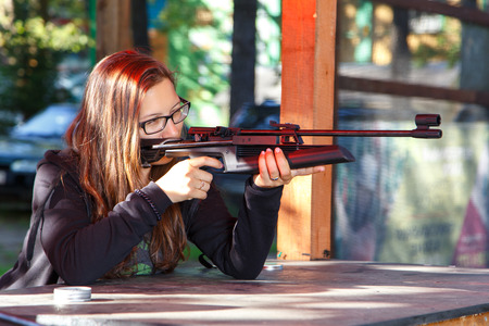 Smart girl shooting from air gun
