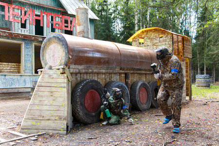 episode: Episode of paintball battle with sign Paintball on background Stock Photo