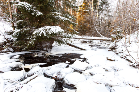 partly: Partly frozen stream in Karelian wood