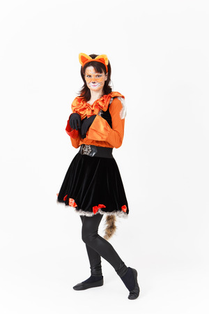 actress: Theatre actress in costume of cat on white background