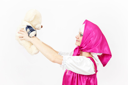 role models: Theatre actress in costume of girl from fairy tale with her teddy bear Stock Photo