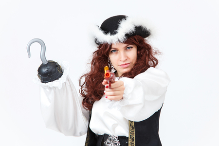 female pirate: Beautiful actress in pirate costume with pistol and hook
