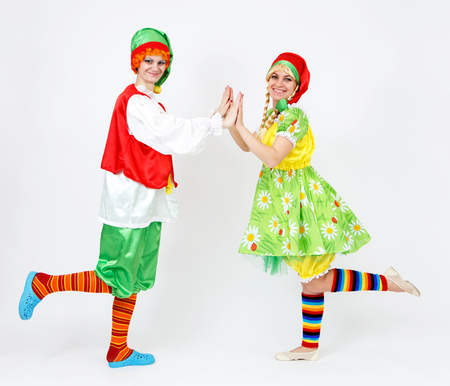 role models: Fairy dwarf girl and her elf friend on white