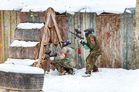 shooters: Cool paintball in winter. Two shooters behind fortifications.