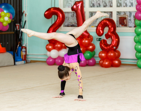 crafty: Elegant girl doing crafty splits on art gymnastics competitions