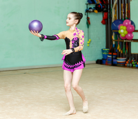 crafty: Cute girl doing crafty trick with ball on art gymnastics performance