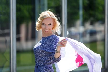 kerchief: Beautiful smiling blond model posing with fluttering kerchief
