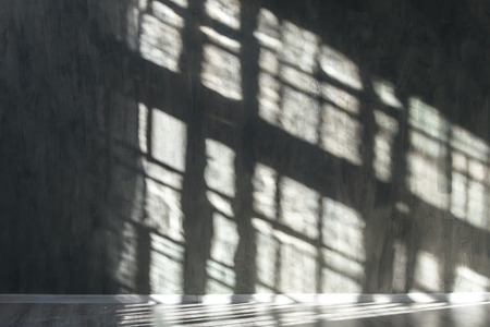 Stone wall with shadows from the window. Background.