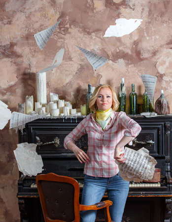 Tired young blond woman throwing her music sheets Banque d'images