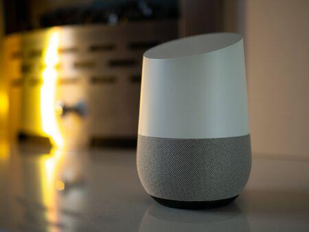 Smart home device speaker on blue floral background Reklamní fotografie