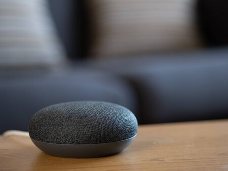 smart home voice activated speaker device in living room lounge