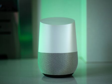 smart home speaker assistant device in home setting with coloured LED mood lighting - green