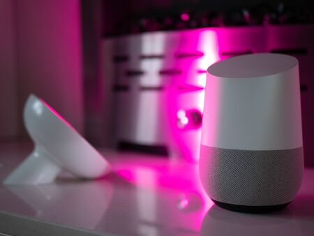 Smart home speaker device lit with colour changing LED lamp light - Pink