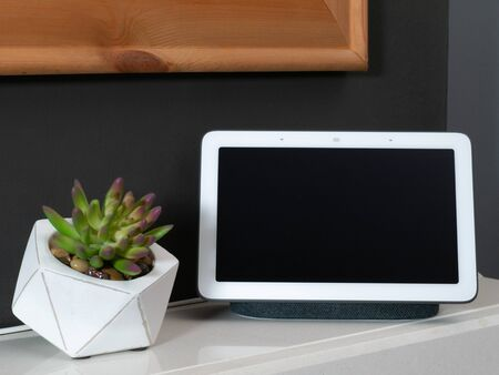 Smart home speaker voice assistant touchscreen in home setting Stock Photo