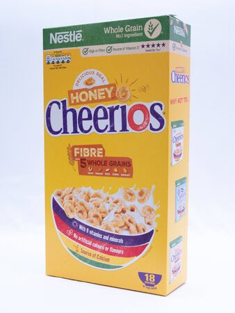 UK, Jan 2020: Nestle Honey Cheerios with whole grain on white studio background