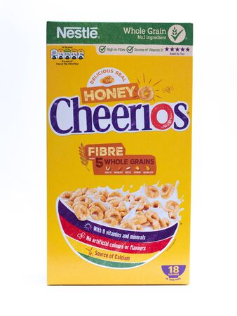 UK, Jan 2020: Nestle Honey Cheerios product shot on white studio background