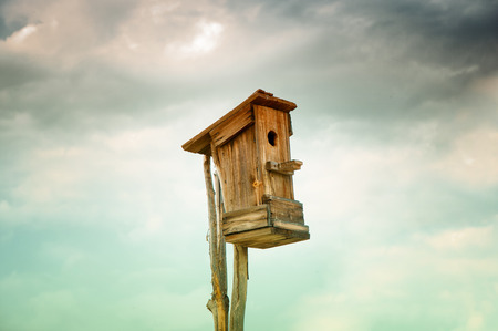 evicted: old birdhouse against the sky
