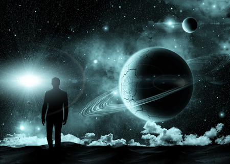 宇宙の風景の背景の上に立っている人