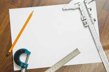 measuring instruments: measuring instruments, pencil and white sheet of paper