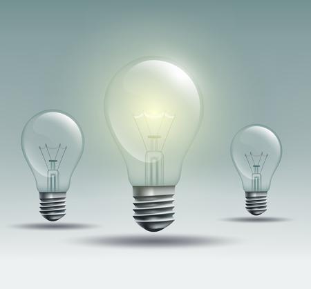bombillo: bombilla de luz sobre un fondo gris