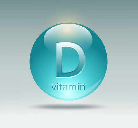 capsule with vitamin D on a gray background
