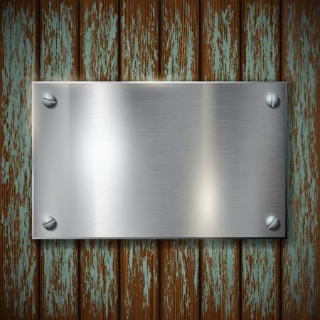 portones de madera: placa de metal en una pared de madera