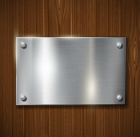 nameplate: metal plate on a wooden surface