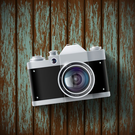camera film: old film camera lying on a wooden surface Illustration